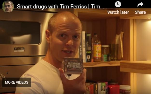 Tim Ferriss holding mushroom coffee packet